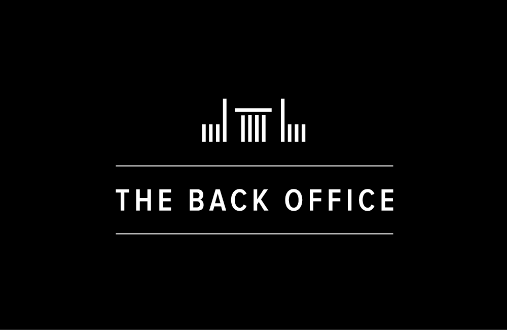 Logo The Back Office. Black background with white minimal lines that form a table and two chairs with backs turned to table.